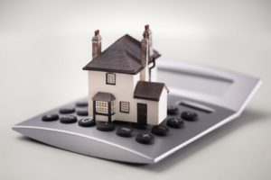 House resting on calculator scaled 1 300x200 - Financial Astrology Predictions 2021